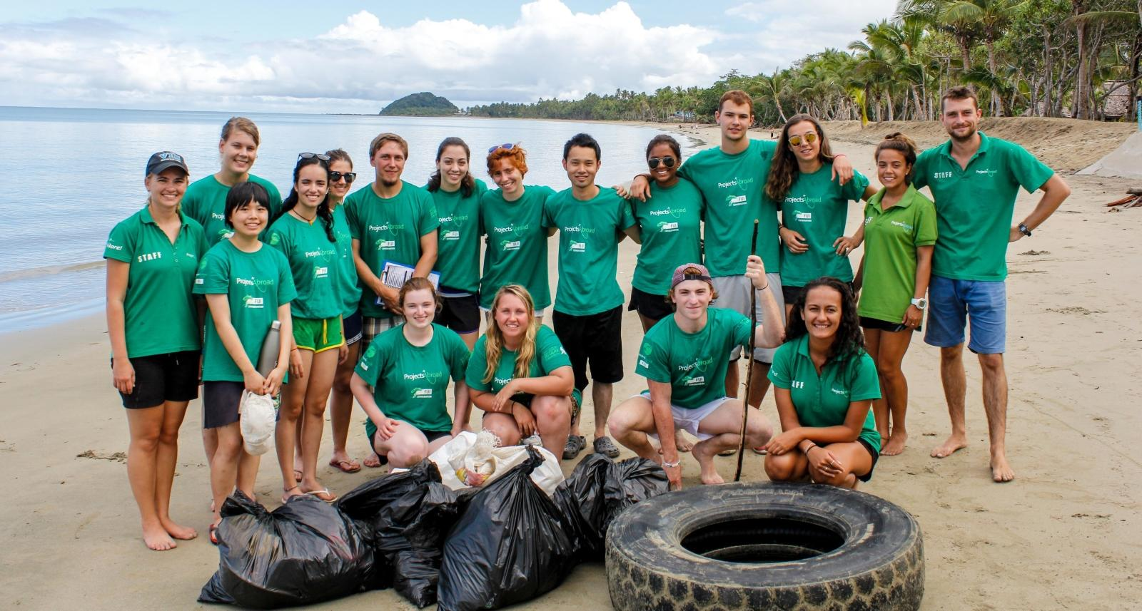rojects Abroad volunteers pose after a successful beach clean up in Fiji